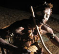 A nganga, bwiti shaman, plays the mugongo, the musical bow